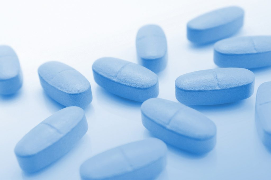 Medical blue background with pills